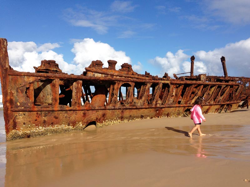 Little girl checking out Maheno Shipwreck, Fraser Island