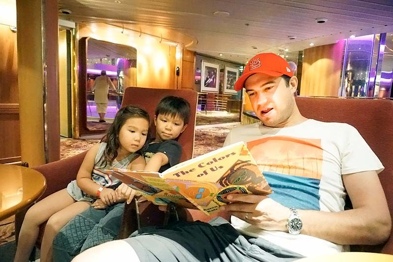Reading borrowed kids books, Library onboard Legend of the Seas